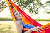 Woman daydreaming in hammock