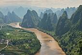 Boat traveling up the scenic Li River, Xingping, Guangxi Autonomous Region, China.