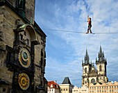 Czech Republic, Prague, historic centre listed as World Heritage by UNESCO, the Old Town (Stare Mesto), Old Town Square (Staromestske namesti), Our Lady of Tyn Church and the Astronomical Clock of the old City Hall, tightrope walker (funambulist).