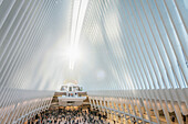 sunrise inside the Oculus, futuristic train station by famous architect Santiago Calatrava next to WTC Memorial, Manhattan, New York City, USA, United States of America