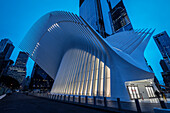 the Oculus exterior during dusk, futuristic train station by famous architect Santiago Calatrava next to WTC Memorial, Manhattan, New York City, USA, United States of America