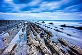 Spain, Euzkadi, Guipuzcoa, Beach and rocks showing rock formation named Flysch