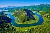 Montenegro, Lake Skadar National Park, View of the river bend of the Rijeka Crnojevica river.