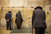 men's prayer area, praying at the Western Wall, Wailing Wall,in Wilson's arch, Jewish Quarter, Old City, Jerusalem, Israel.
