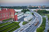 Aleja Solidarnosci street, at left The Royal Castle, in background Vistula river, Warsaw, Poland.
