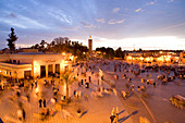 Morocco, Haut Atlas, Marrakesh, Imperial city, Medina listed as World Heritage by UNESCO, sunset over Jemaa El Fna square