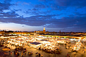 Morocco, Haut Atlas, Marrakesh, Imperial city, Medina listed as World Heritage by UNESCO, Jemaa El Fna square at sundown
