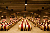United States, California, Napa Valley, Oakville, Robert Mondavi Winery, the cellars with its oak barrels, tasting