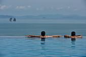 couple in the pool on Ko Yao Yai Island in the Andaman Sea, Thailand