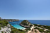 People swimming in the bay of Calo des Moro, Mallorca, Spain