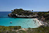 People swimming in the bay of Calo des Moro, Mallorca, Spain