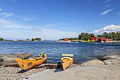 Kayaks on the beach in Langvik, island of Moeja in Stockholm archipelago, Uppland, Stockholms land, South Sweden, Sweden, Scandinavia, Northern Europe