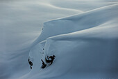 Snow-covered cliffs in the mountains, Andermatt, Uri, Switzerland