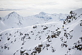 Young male skier standing in the deep powder snow apart the slopes, Andermatt, Uri, Switzerland