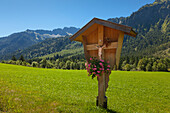 Wayside cross at Hinterstein valley, near Bad Hindelang, Allgaeu Alps, Allgaeu, Bavaria, Germany