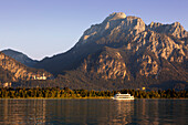 Excursion ship on lake Forggensee, view to Neuschwanstein castle, Hohenschwangau castle and Saeuling, Allgaeu Alps, Allgaeu, Bavaria, Germany