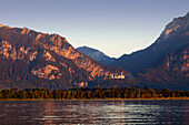 View over lake Forggensee to Neuschwanstein castle, Allgaeu Alps, Allgaeu, Bavaria, Germany