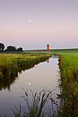 Pilsum lighthouse at full moon, near Greetsiel, East Friesland, Lower Saxony, Germany