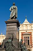 Poland, Lesser Poland region, Krakow, the statue of Adam Mickiewicz on the Market Square (Rynek Glowny)