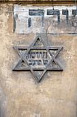 Poland, Lesser Poland region, Krakow, Kazimierz Jewish quarter, facade of a house with the Star of David