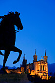 France, Rhone, Lyon, historical site listed as World Heritage by UNESCO, equestrian statue of Louis XIV on place Bellecour (Bellecour Square) and Notre Dame de Fourviere Basilica