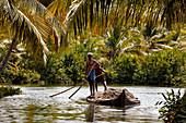 India, Kerala State, near Kollam, Munroe island, dugout canoe transporting sand