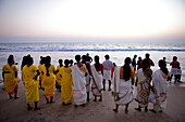 India, Kerala State, seaside resort of Varkala, on the beach the indians are watching the sun go down