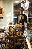 Waiter with dessert cart at Robuchon au Dome restaurant at Grand Lisboa Hotel & Casino, Macau, Macau, China