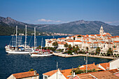 Motor sailing cruise ship M/S Panorama (Variety Cruises) and other sailboats at pier with Korcula Old Town and St. Mark's Cathedral, Korcula, Dubrovnik-Neretva, Croatia