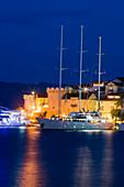 Motor sailing cruise ship M/S Panorama (Variety Cruises) at pier with Korcula Old Town fortress at night, Korcula, Dubrovnik-Neretva, Croatia