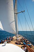 Passengers relax on deck of motor sailing cruise ship M/S Panorama (Variety Cruises), Adriatic Sea, near Albania