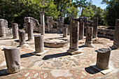Mosaic floor and columns in 6th century baptistry in ancient city of Butrint (UNESCO World Heritage Site) in Butrint National Park, Butrint, near Saranda, Vlorë, Albania