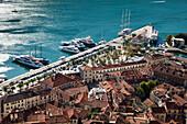 Overhead of Kotor Old Town with motor sailing cruise ship M/S Panorama (Variety Cruises) at pier, Kotor, Montenegro