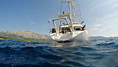 Water's edge view of motor sailing cruise ship M/S Panorama (Variety Cruises) during swim stop, near Korcula, Dubrovnik-Neretva, Croatia