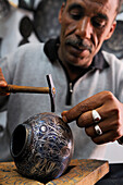 Morocco, Meknes Tafilalet Region, Meknes, Imperial City, medina listed as World Heritage by UNESCO, craftsman making damascening with silver