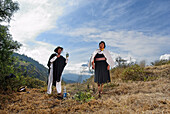 Ecuador, Tungurahua Province, Andes, facing Tungurahua volcano, the shaman of Salasaca throws alcohol for a cleansing