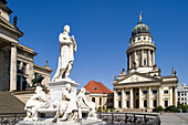 Germany, Berlin, Gendarmenmarkt, French church built between 1701 and 1705 by architects Louis Gayard and Abraham Quesnay and the marble statue of Schiller