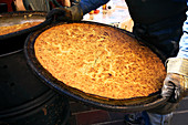 France, Alpes Maritimes, Nice, Old Town, Cours Saleya, preparing the socca, flat cake and speciality of the region