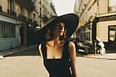 Glamorous Caucasian woman standing in city street