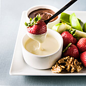 Strawberry dipping in white sauce
