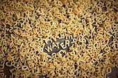 Alphabet noodles spelling water