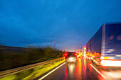 A1 German Autobahn, congestion, night, lights, trucks, tail lights, brake lights, motorway, highway, freeway, speed, speed limit, traffic, infrastructure, Germany