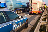 German Autobahn, A 2, police car,  Autobahn police, patrol, control of truck, uniform, crash barrier, guardrail, hard shoulder, motorway, freeway, speed, speed limit, traffic, infrastructure, Hanover, Germany