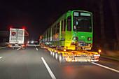 A 27, heavy load, oversize, night, transporting a tram, German Autobahn, motorway, freeway, speed, speed limit, traffic, infrastructure, Germany
