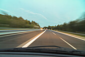 German Autobahn, A 7, driving, motion, blurred, windscreen, front view, motorway, highway, freeway, speed, speed limit, light traffic, infrastructure, Germany