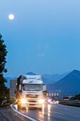 German Autobahn, A 8, Alps, moon, oncoming truck, landscape, hills, trucks, motorway, highway, freeway, speed, speed limit, traffic, infrastructure, hills, evening,  Bavaria, Germany