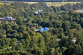 German Autobahn, A 99, blue signs amongst trees, motorway, highway, freeway, speed, speed limit, traffic, infrastructure, hills, Münich, Bavaria, Germany