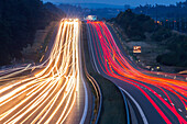 German Autobahn, A 9, driving, motorway, highway, freeway, speed, speed limit, traffic, night, lights, tail lights, hill, oncoming lights, infrastructure, near Nürnberg, Germany
