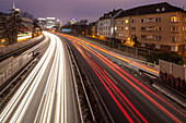 German Autobahn A 40, noise barrier, wall, tail lights light trails, night, motorway, highway, freeway, speed, speed limit, traffic, infrastructure, Essen, Germany