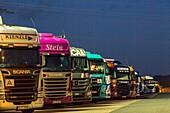 parked trucks at night, German Autobahn, A45, truck stop, motorway, highway, freeway, speed, speed limit, traffic, infrastructure, Wilnsdorf, Germany